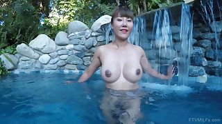 Asian exotic MILF Tiffany spreads her pussy with regard to a pool