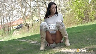 Super confident Eveline Neill has piss flowing from her pussy outdoors