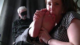 Girl Licks The Feet Of An Older Man
