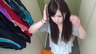 Horny Japanese babe is trying on swimsuit and she's got a luscious snatch