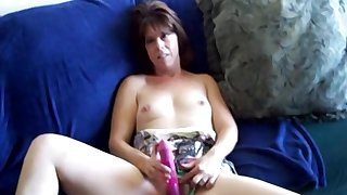 Full-grown amateur lady sucks cock and uses a satisfying pink toy