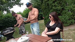 Middle elderly woman is fucked by two young hot guys apropos the mutual