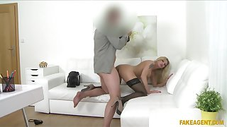 Fake-chested MILF shows nigh to an agent's office desiring to wow him