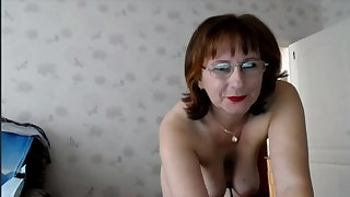 Mature with glasses on webcam