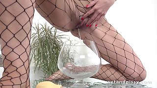 Pissing tattooed nympho Ali Bordeaux wipes her urine off and goes solo