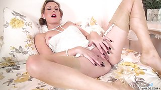 Dirty mature Mrs Huntingdon Smythe opens her legs forth finger her cunt